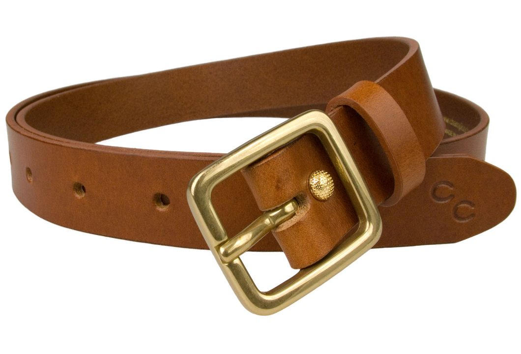 Womens Tan Leather Belt Solid Brass Buckle 1 Inch Wide. ( 2.5 cm ). British Made High Quality Leather Belt. Italian Full Grain Leather. Champion Chase Double Horse Shoe Motif to tip of belt. Ornate Gold Plated Rivet to fasten Belt Return.
